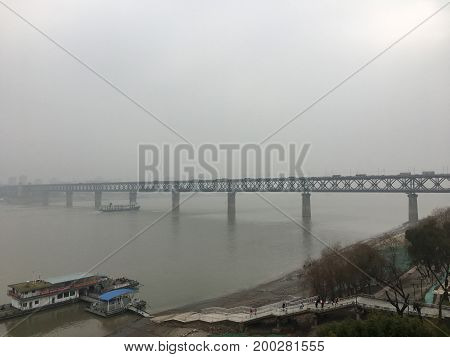 Old double deck bridge Wuhan Yangtze river Great Bridge on pollution day