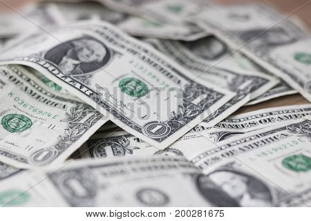 Close up of a pile of one dollar bills