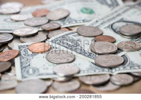 Close up of a pile of various American currency