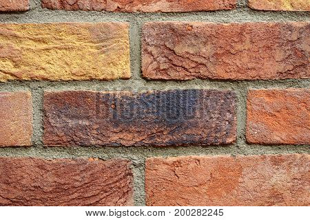 Colourful old brick wall texture background pattern.