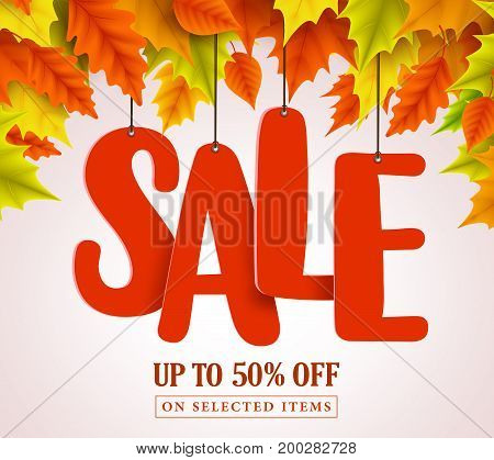 Autumn sale vector design with red sale text hanging in colorful maple leaves for fall seasonal marketing promotion. Vector illustration.
