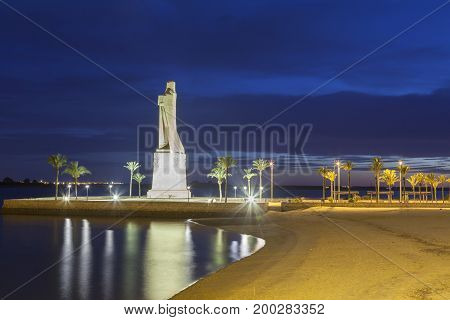 Christopher Columbus monument in the city of Huelva illuminated at night. Andalusia Spain