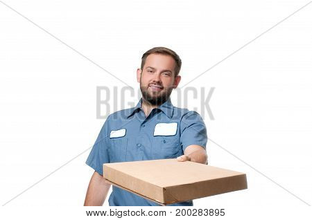 Portrait Of Happy Delivery Man With Cardboard Box