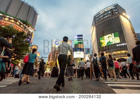 Tokyo. July 18 2016. The shibuya district in Tokyo. Shibuya is popular district in Tokyo and work district shopping district. That Locals and tourists go to travel Top-rated 1 in 10 in Japan. (Portrait of man japan and tourists walk across the crosswalk)