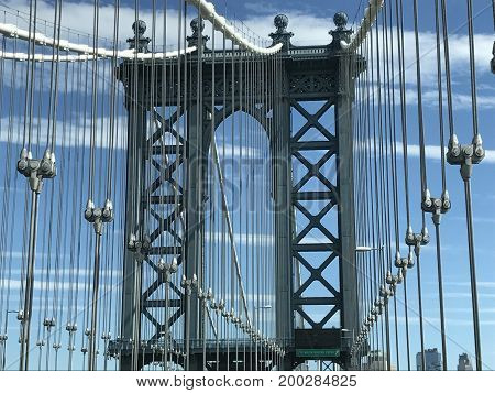 NEW YORK, NY - JUN 24: Manhattan Bridge in New York City, seen on June 24, 2017. is a suspension bridge that crosses the East River in New York City, connecting Lower Manhattan with Downtown Brooklyn.