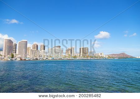 Honolulu cityscape with Diamond Head mountain in a view Hawaii USA. A view on Honolulu from the bay in early morning.