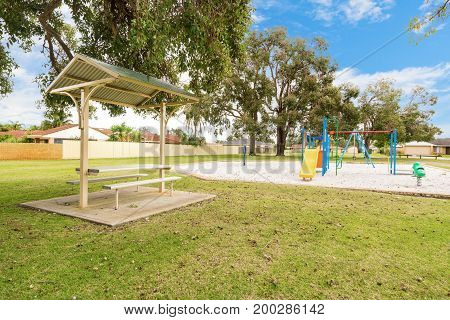 Park and playground in suburban area in Perth, Western Australia, on a sunny day.