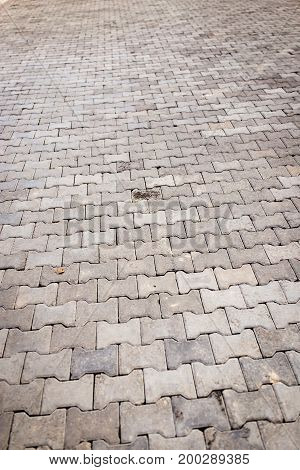 Paving stone on the road as a background .