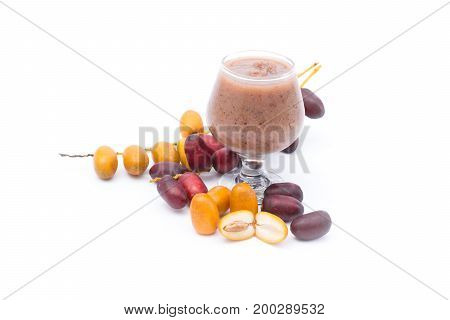 Fresh of Date palm (Phoenix dactylifera) and Date palm juice isolated on white background