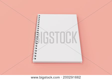 Closed Notebook Spiral Bound On Red Background