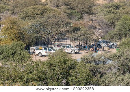 ETOSHA NATIONAL PARK NAMIBIA - JUNE 24 2017: Camping sites in the Okaukeujo Rest Camp in the Etosha National Park as seen from the watchtower