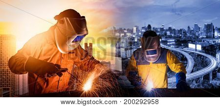 Welding worker welding steel structure with expressway and modern city in background for construction industrial work concept
