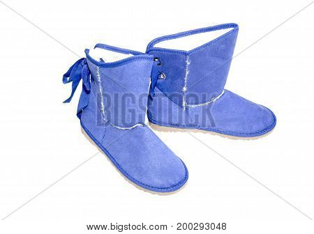Winter, women's blue boots on a white background closeup