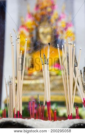 Incense in a pot at the Buddha image. Faith faith blessings fortune in Buddhism.