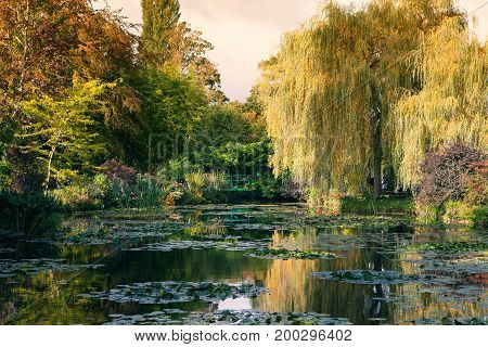Claude Monet the garden in autumn, water lilies in the lake on a Sunny day, Giverny, France