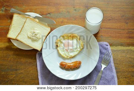 fried egg and pork sausage with bread eat couple milk breakfast set