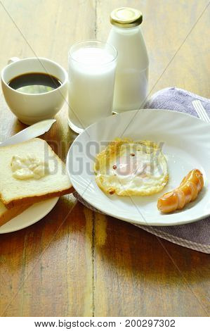 fried egg and pork sausage with bread eat couple coffee cup breakfast set