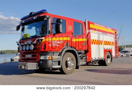 Mariefred Sweden - August 14 2017: Red fire truck belonging to the rescue service in Strangnas municipality's fire station in Mariefred.