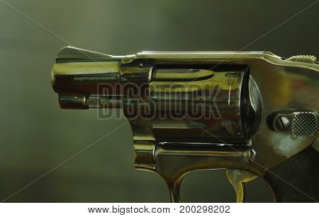 revolver gun ready to shoot on black background