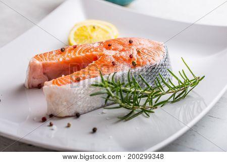 Salmon. Raw Salmon Steak With Rosemary Lemon Salt And Pepper