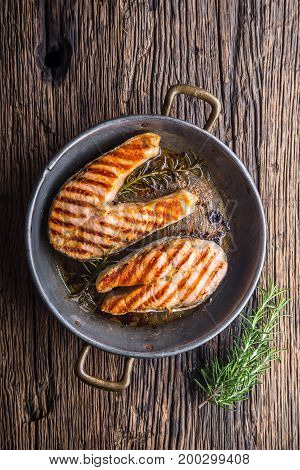 Salmon. Grilled Fish Salmon. Grilled  Salmon Steak In Roasted Pan On Rustic Wooden Table