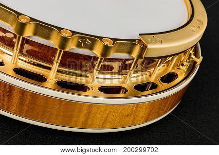 Mahogany banjo luxury gold on a black background