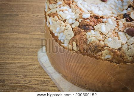 Dessert and Sweet Food Traditional Honey Cake Topped with Caramel Resins and Almonds on A Wooden Table with Copy Space for Text Decoration.