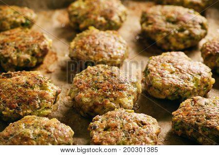Turkey fritters with broccoli and leek , with garlic yogurt dip.