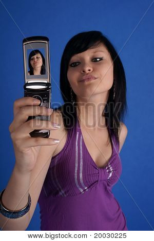 Girl taking autoportrait and posing