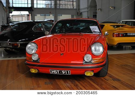 SYDNEY AUSTRALIA - JULY 29 2014: Fire red Porsche 911 Carrera car old classic retro model on display for purchase