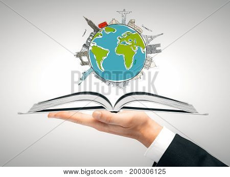 Hand holding open book with traveling sketch. Sightseeing concept. 3D Rendering