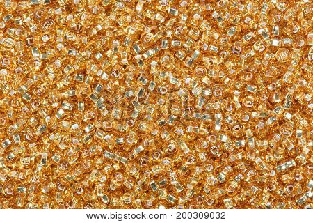 Yellow corn seed beads background. High resolution photo.