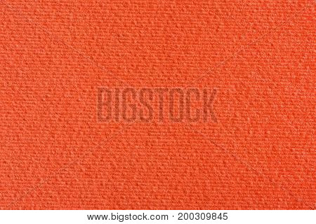 Orange lined paper background. High resolution photo.