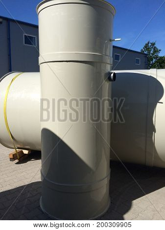 Two cylindrical custom welded plastic polypropylene tanks