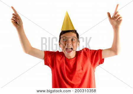 Young teenage boy isolated on white celebrating at a party
