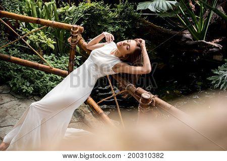 Seductive Woman In Tropical Orangery