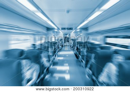 Blurred image of interior of the passenger carriage in the highspeed train.
