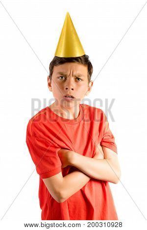 Young teenage boy isolated on white looking cross at a party