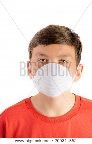 Young teenage boy isolated on a white background wearing a face mask