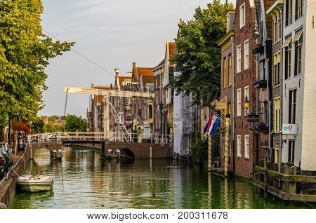 ALKMAAR THE NETHERLANDS - AUGUST 25 2013: Urban landscape in Alkmaar the Netherlands canal view