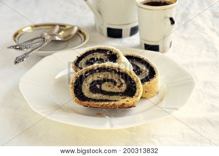 Poppy seed roll slices sprinkled with powdered sugar