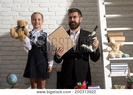 Schoolgirl And Father With Happy And Confused Faces