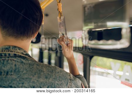 Male Hand Holding Onto A Handle Of Bus