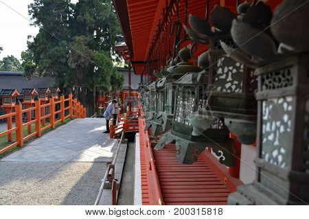 People Praying At Kasuga Taisha, The Famous Shrine In Nara (japan) - Focus On The People