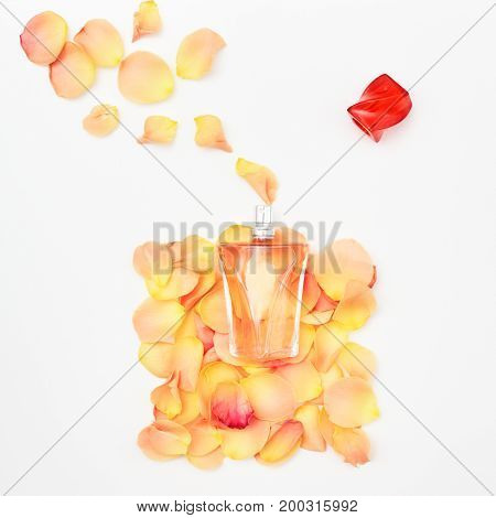 Delicate Roses And Perfume Bottle On A White Background
