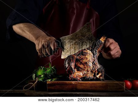 Man cuts appetizing fragrant fried beef on a cutting board