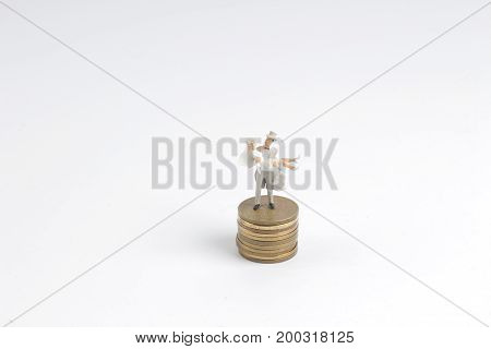 Plastic Wedding Couple On A Pile Of Coins
