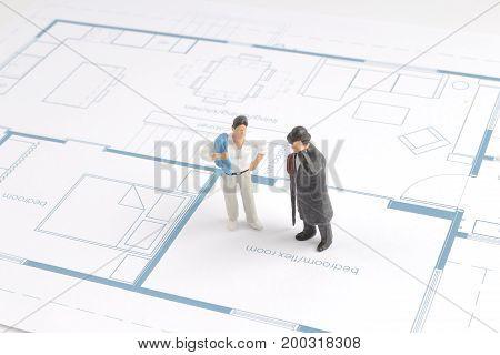 Small Businessman Examining An Architech Blueprint