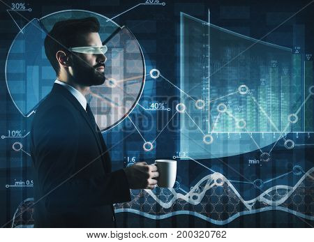 Side view of thoughtful young businessman with coffee cup and virtual glasses on abstract business screen background. Analytics and media concept. Double exposure