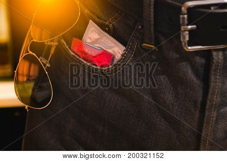 Condoms in package in jeans. Protection against AIDS. Safe sex concept. contraception and birth control. Protection against unwanted pregnancy.